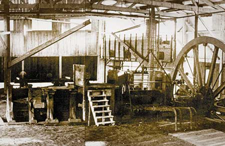 Interior photo of the Brandywine Iron Works taken about 1870. The water-powered flywheel turned the rolls of the mill.