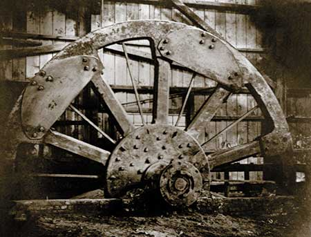 Renovations to the Brandywine Rolling Mill in 1834 included a new flywheel to improve rolling efficiency.
